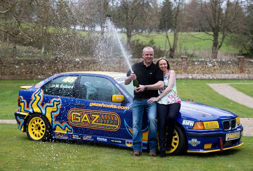 Car mechanic and racing driver Neil Trotter, with partner Nicky Ottaway, celebrates his win in Dorking, Surrey where he was revealed as the man who scooped a £107.9m (€128.6m) jackpot on the Euromillions lottery.
