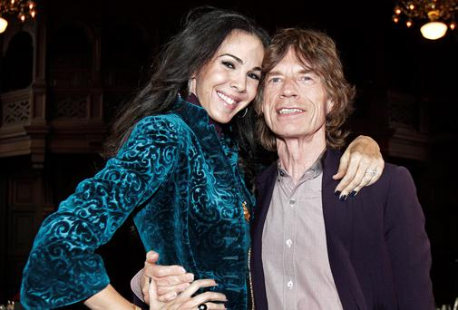 Mick Jagger said he and girlfriend L'Wren Scott were still 'absolutely' an item when the fashion designer took her own life on Monday