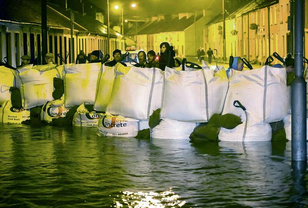 Sandbags were used to keep the water at bay in Waterford during the recent storms. Photo: Patrick Browne