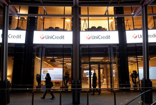 "UniCredit Bank Ireland's exposure to Italian and Spanish sovereign debt exceed ""permitted large exposure limits"" on dates in 2011 and 2012, the central bank said yesterday"
