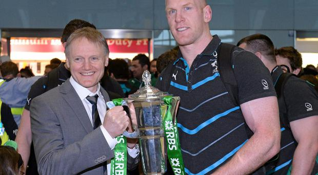 Ireland head coach Joe Schmidt and captain Paul O'Connell with the RBS Six Nations Rugby Championship 2014 trophy