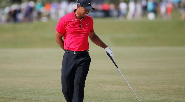 Tiger Woods grimaces after playing a bunker shot at the WGC in Florida earlier this month