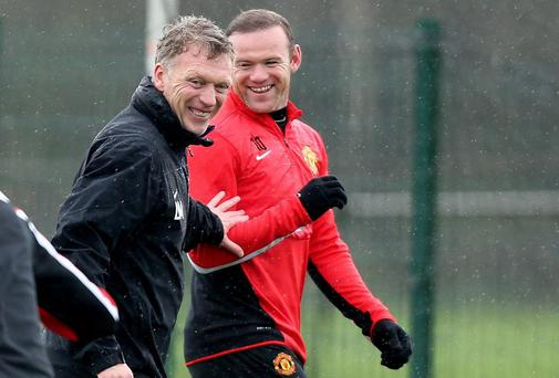 Manchester United manager David Moyes and Manchester United's Wayne Rooney during training