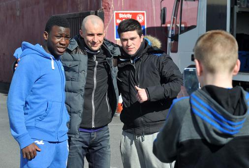 Tom Vaughan-Lawlor, who plays gang leader Nidge, posed with fans yesterday as Love/Hate returned to filming
