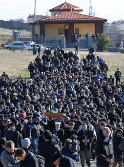 Crimean Tatars gather at a cemetery for the funeral of Reshat Ametov outside the town of Simferopol
