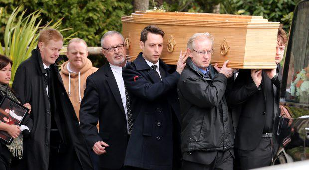 The remains of Marie Carroll are carried by her son Steven along with friends and family after her funeral mass at the Church of Our Lady of Mount Carmel in Firhouse. 19/03/14 Pic Frank Mc Grath