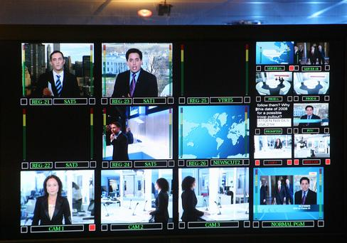Screens in a news TV channel stage-managing room.