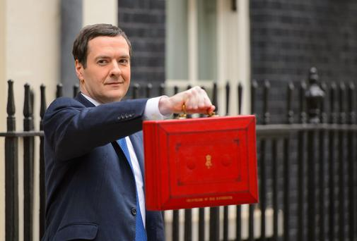 Chancellor of the Exchequer George Osborne outside 11 Downing Street before heading to the House of Commons to deliver his annual Budget statement. Photo: Dominic Lipinski/PA Wire