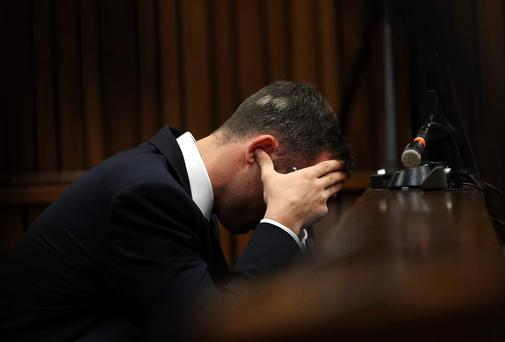 Oscar Pistorius blocks his ears during court proceedings today
