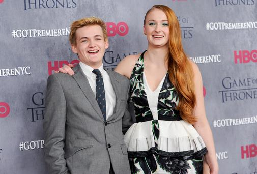 "Actors Jack Gleeson and Sophie Turner attend HBO's ""Game of Thrones"" fourth season premiere at Avery Fisher Hall in New York. (Photo by Evan Agostini/Invision/AP)"