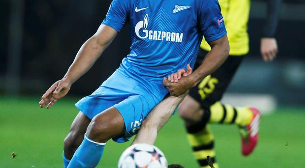 Borussia Dortmund's Sokratis Papastathopoulos (front) is tackled by Zenit St Petersburg's Jose Rondon during their Champions League round of 16 second leg soccer match in Dortmund. Reuters/Wolfgang Rattay