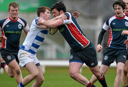 Matthew Cosgrove, Sligo Grammar, is tackled by Sean Horan, Garbally College, Ballinasloe