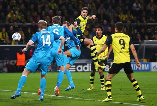 Sebastian Kehl rises highest to score for Dortmund against FC Zenit at Signal Iduna Park