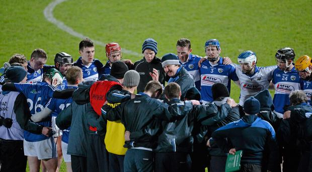 Laois manager Seamus Plunkett with his players