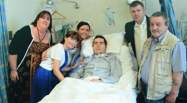 David surrounded by his family on his sister's wedding day