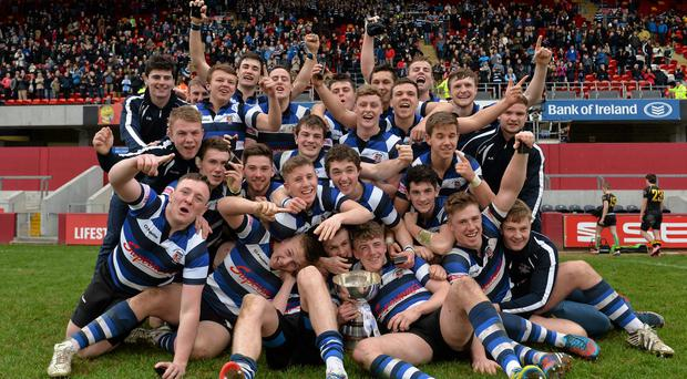 The Crescent College players celebrate with the cup after defeating Ardscoil Ris