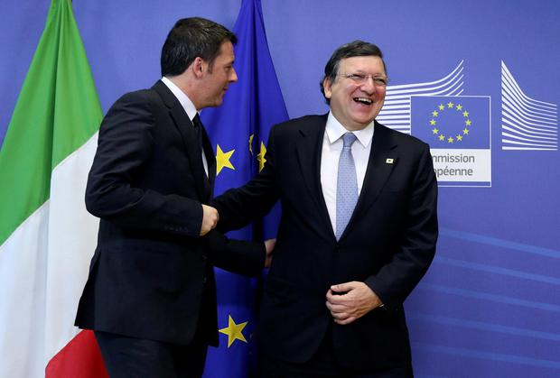 European Commission President Jose Manuel Barroso with Italy's Prime Minister Matteo Renzi at the European Union leaders summit in Brussels