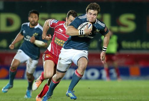 Munster's Gerhard Van Den Heever on the break against Scarlets earlier this month
