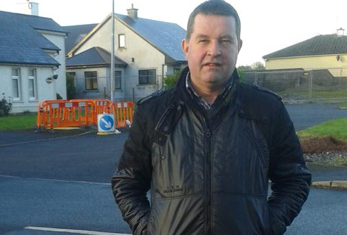 Cllr Paschal Fitzmaurice at the water meter installation sites in Castlerea.