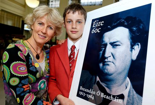 Blanaid Walker and her son Rupert (13) at the launch of the new Brendan Behan stamp in the GPO in Dublin.