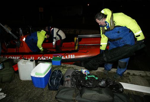 Members of Athlone Sub Aqua Club offloading the three fishermen's equipment and belongings found out on the lough. Photo: molloyphotography