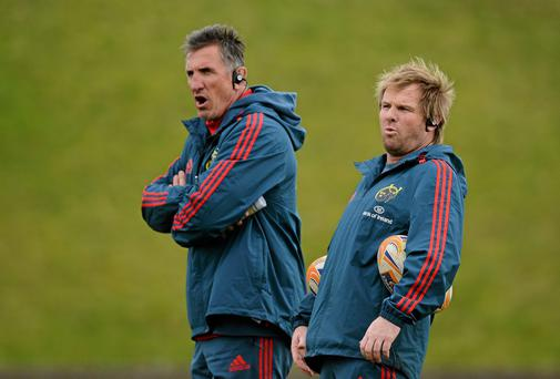 Munster head coach Rob Penney, left, and backs coach Simon Mannix