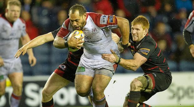 John Afoa, Ulster, is tackled by Roddy Grant, Edinburgh