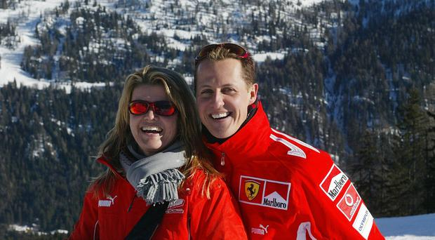 German Formula 1 driver Michael Schumacher poses with his wife Corinna