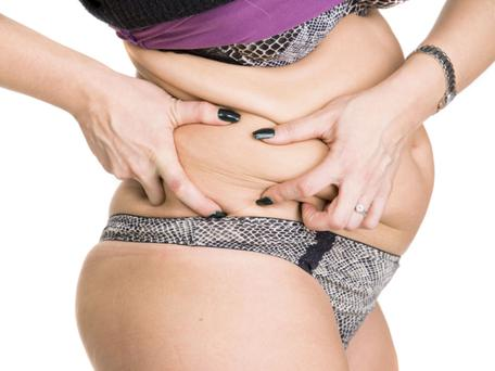 How can I lose the fat around my belly. Picture posed. Thinkstock