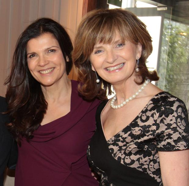 Adi Roche (right), pictured with Ali Hewson, said it broke her heart to put her charity's heart surgery programme on hold due to violence in the Ukraine