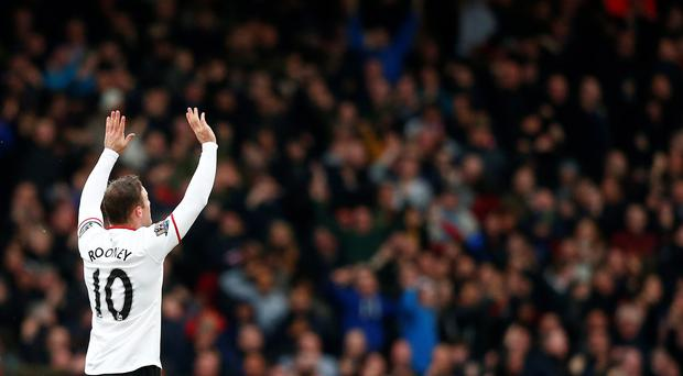 Manchester United's Wayne Rooney celebrates after scoring a wonder goal against West Ham United.