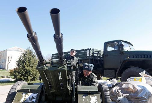 Ukrainian servicemen guard a military base in the Crimean town of Belbek near Sevastopol