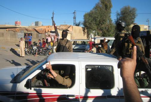 Al Qaeda fighters celebrate on vehicles taken from Iraqi security forces on a main street in Fallujah, 70 km (43 miles) west of Baghdad
