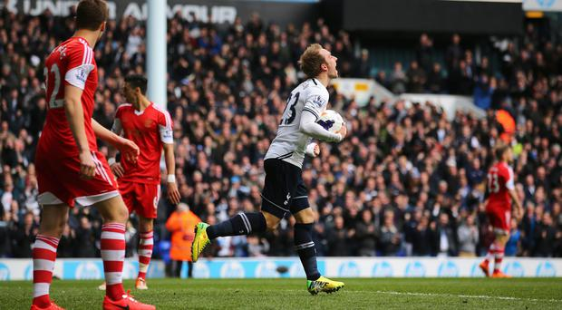 Christian Eriksen celebrates scoring his second goal against Southampton at White Hart Lane