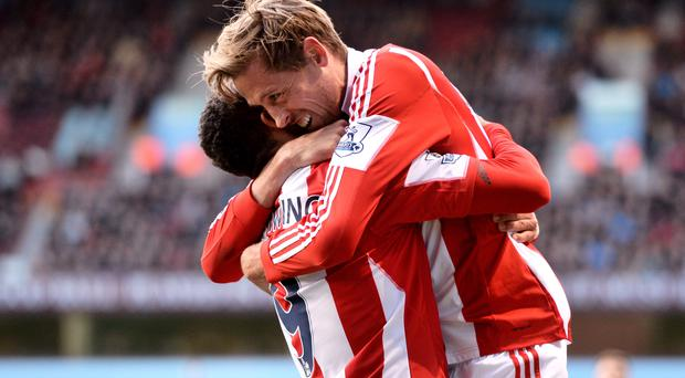 Peter Odemwingie celebrates with teammate Peter Crouch after scoring against Aston Villa at Villa Park.