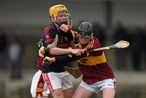Cathal McGrath, Kilkenny CBS, in action against Dean Coleman, Scoil na Trinóide Naofa