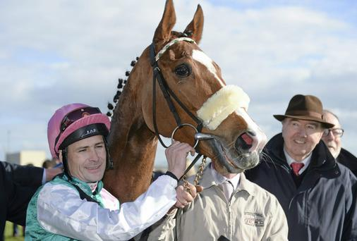 Jockey Pat Smullen with Vote Often and trainer Dermot Weld in the winners enclosure