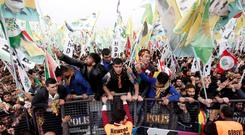 People take part in a gathering to celebrate Newroz, which marks the arrival of spring and the new year in Istanbul