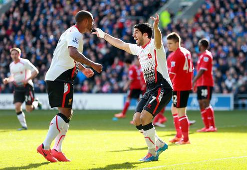 Liverpool's Luis Suarez celebrates scoring their first goal with Glen Johnson at Cardiff City Stadium