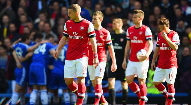 Arsenal players dejected as Chelsea record emphatic win at Stamford Bridge