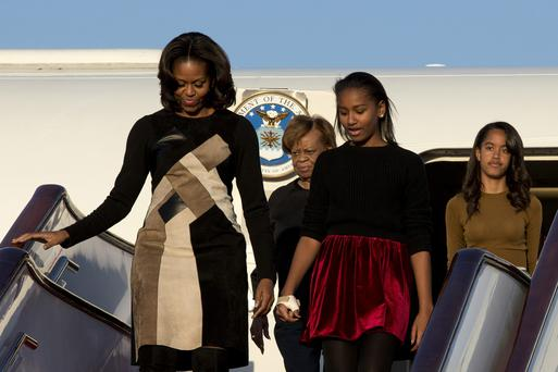 First Lady Michelle Obama with her mother Marian Robinson, daughters Sasha Obama and Malia Obama arrives at Beijing Capital International Airport on March 20, 2014 in Beijing, China. The first lady arrived in Beijing with her mother, Marian Robinson, and daughters to kick off a six-day tour where she will focus on education and cultural exchange. (Photo by Alexander F. Yuan - Pool /Getty Images)