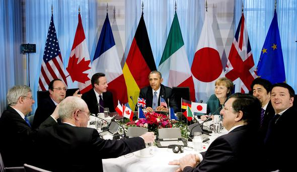 U.S. President Barack Obama (C) participates in a G7 leaders meeting during the Nuclear Security Summit in The Hague