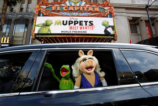 The characters of Kermit and Miss Piggy arrive at the premiere of