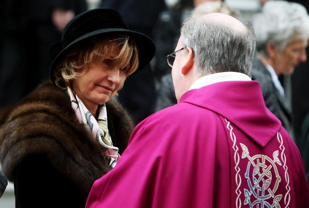 The wife of Lord Ballyedmond, also known as Dr Edward Haughey, Mary (left) speaks with Canon Francis Brown outside Newry Cathedral, Co. Down, following his requiem mass.