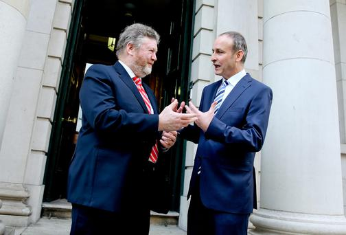 Minister for Health James Reilly meets Fianna Fail leader Michael Martin to mark the 10th anniversary of the smoking ban in Ireland at the Royal College of Physicians. Picture: Maxwell's