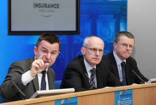 Brian Hayes, Minister of State at the Department of Public Expenditure and Reform with special responsibility for the Office of Public Works (OPW), with Kevin Thompson, CEO of Insurance Ireland (II). Photograph: Conor Healy