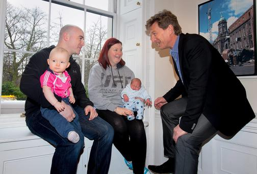 Simon Doyle, partner Audrey Gaynor with their children Charlie 11 months & Jack 2 weeks all from Clondalkin & One big Switch Co-Founder Oliver Tattan Photo: Gareth Chaney Collins