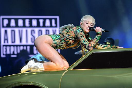Miley Cyrus performs at AmericanAirlines Arena on March 22, 2014 in Miami, Florida. (Photo by Larry Marano/Getty Images)