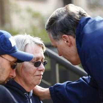 Governor Jay Inslee talks privately with two residents affected by the mudslide