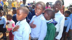 Children sing and dance for Irish volunteers who are working on their new school building in Bizana, Eastern Cape, in South Africa